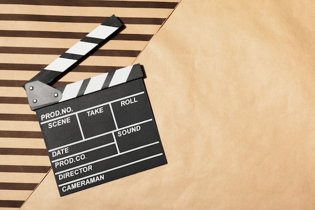 Film clapper board on a table