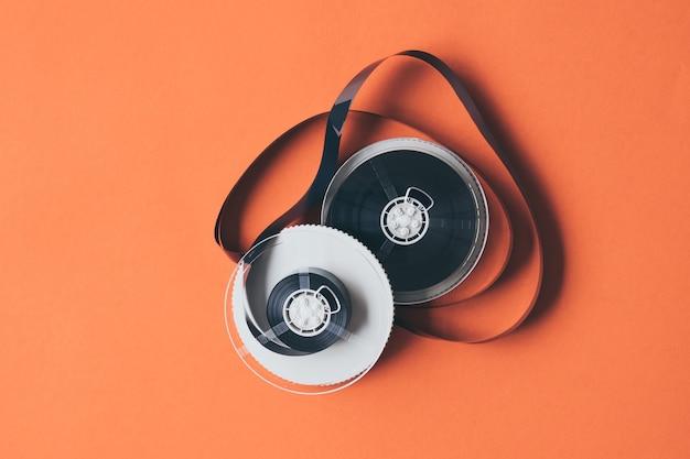 Пленка для кассетной ленты на оранжевом фоне.