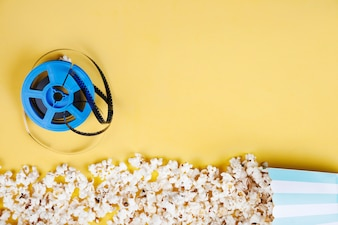 Film reel near popcorn line from box