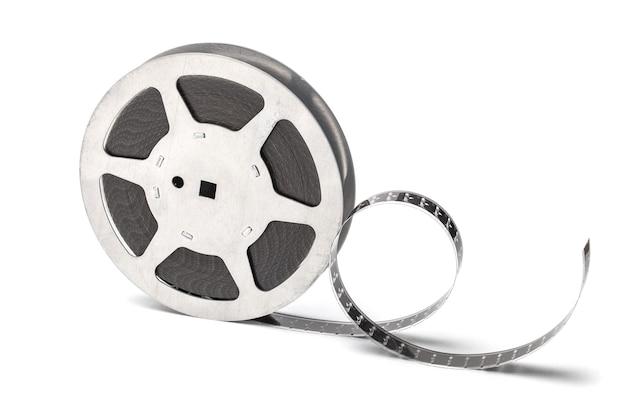 白い背景で隔離のフィルムストリップとフィルムリール。