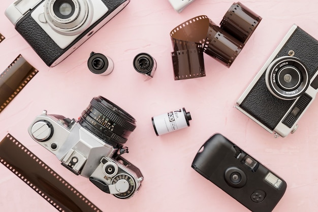 Film rolls amidst retro cameras