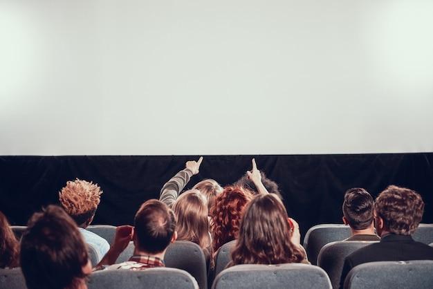 Film screening in cinema. viewing new movie.