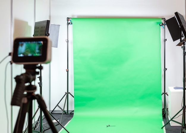Filming or photography studio set with green screen.