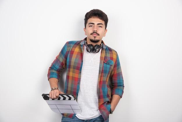 Filmmaker holding a blank white clapper board.