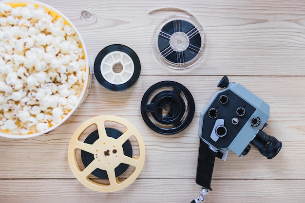 Filmstrips with popcorn and camera