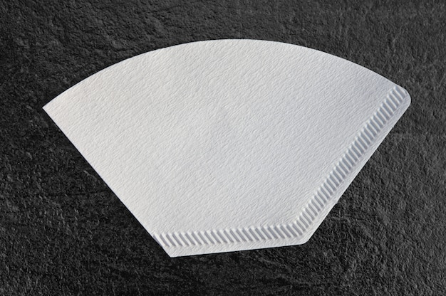 Filter papers.isolated on a dark table background with clipping path for all types and brand of filter coffee machines