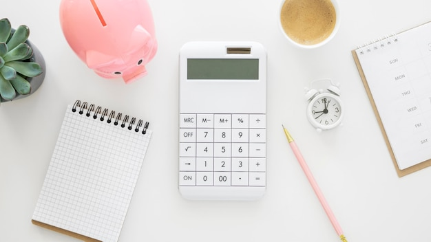 Finance elements arrangement with empty notepad and calculator