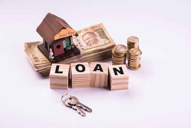 Finance and housing loan or purchase in india -  concept showing 3d house model, indian currency notes and calculator etc