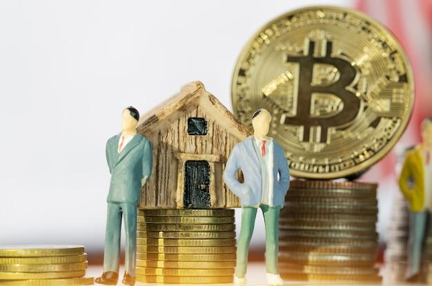 Finance investment risk internet: miniature business standing near bitcoin digital