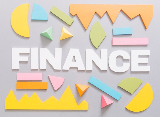 Finance word with colorful graph and geometric shapes on gray background