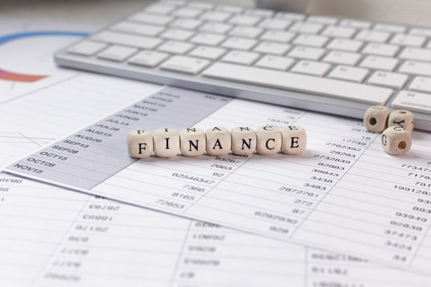 The finance word on wood cube business content image.