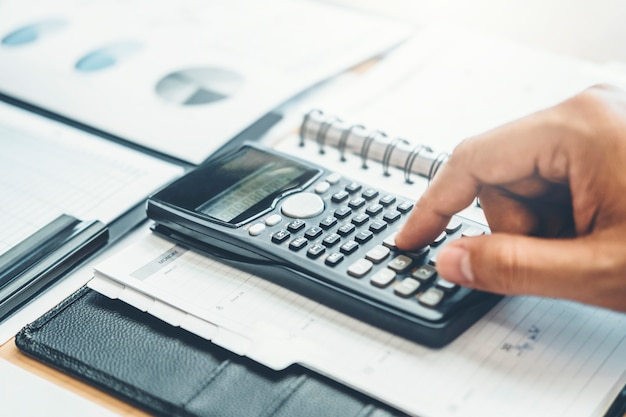 Financial business man accounting calculating cost economic budget investment