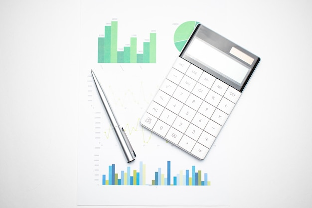 Financial charts and a calculator on the accountant's desk. calculating profits, taxes, and paying employees salaries.