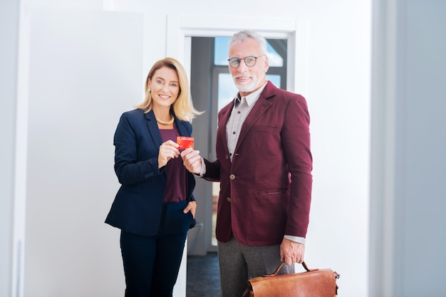 Financial club. blonde-haired estate agent inviting her influential prosperous friend joining their financial club