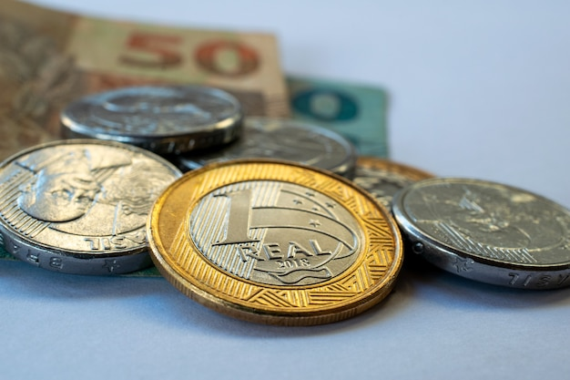 Financial control concept with brazilian money, coins and banknotes.