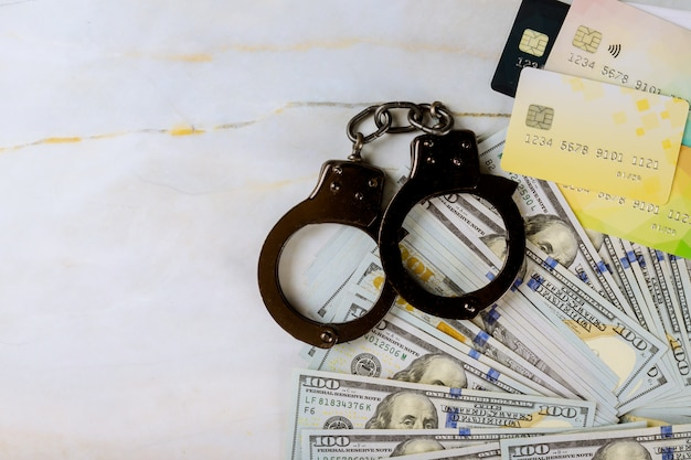 Financial crimes credit cards and dollar bills handcuffed stealing credit card money and fingerprint record us dollar banknotes money cash corruption