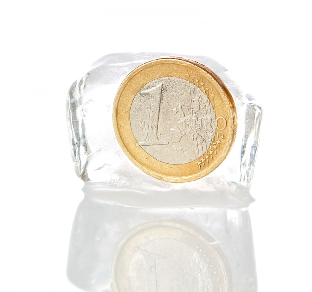 Financial crisis in europe, inflation, the euro. euro frozen on a white wall.