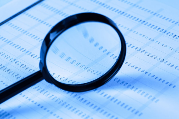 Financial documents with magnifying glass
