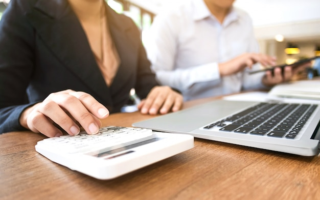 Financial inspecter with accountant working at a modern office