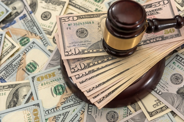 Financial judges gavel with dollars  corruption crimes