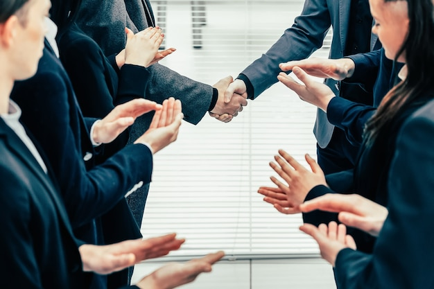 Financial partners are shaking hands with each other
