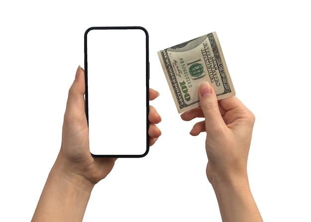 Финансовые платежи долларовыми деньгами и мобильным телефоном, пустой белый макет экрана, руки с монетой криптовалюты, изолированные на белом фоне фото