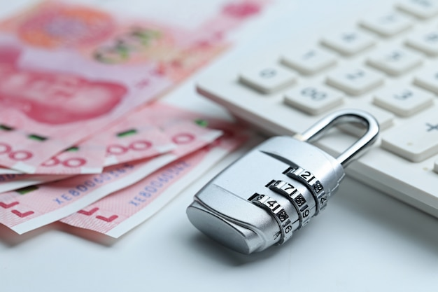 Financial security password lock and banknotes on white background