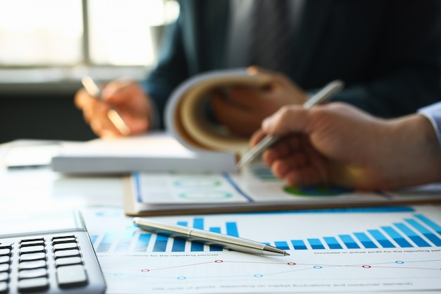 Financial statistics documents ball pen