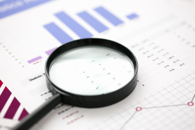 Financial statistics documents with lens at office table