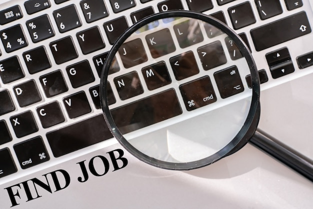A find job text on the keyboard computer opportunity vacations search