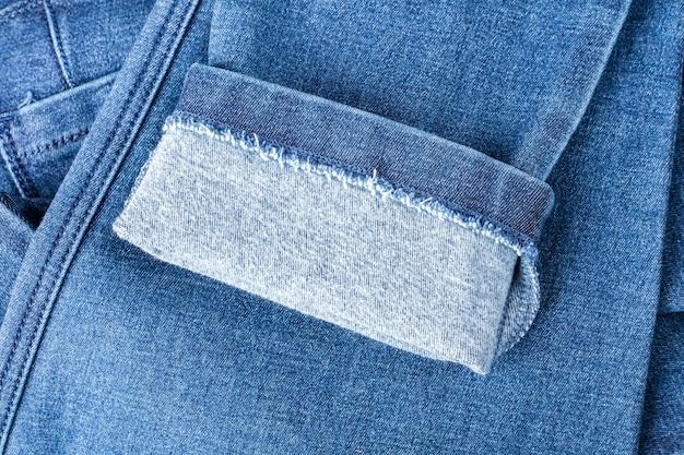 Тонкая деталь джинсовой ткани. синяя шерстяная фактура из замшевой ткани. фон, текстура