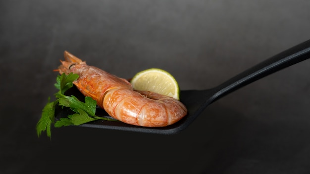 Fine selection of jumbo shrimps with lemon and parsley.