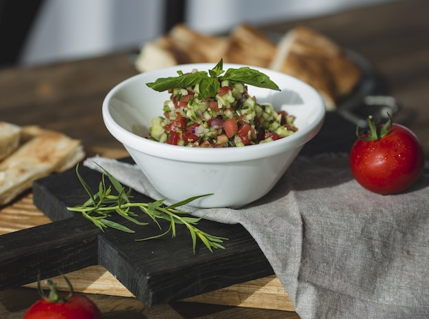 Finely minced vegetable salad with herbs and spices