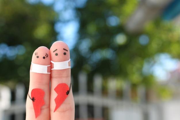 Finger art of couple in medical masks