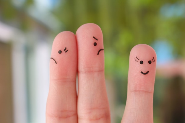 Finger art of family during quarrel. a couple arguing, another woman is happy.