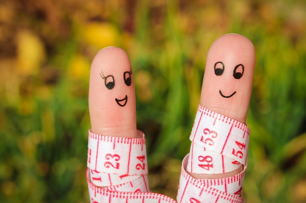 Finger art of a happy couple with meter