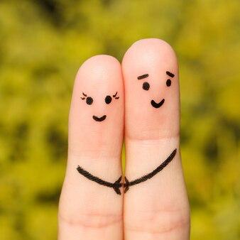 Искусство пальца счастливой пары. счастливая пара, взявшись за руки