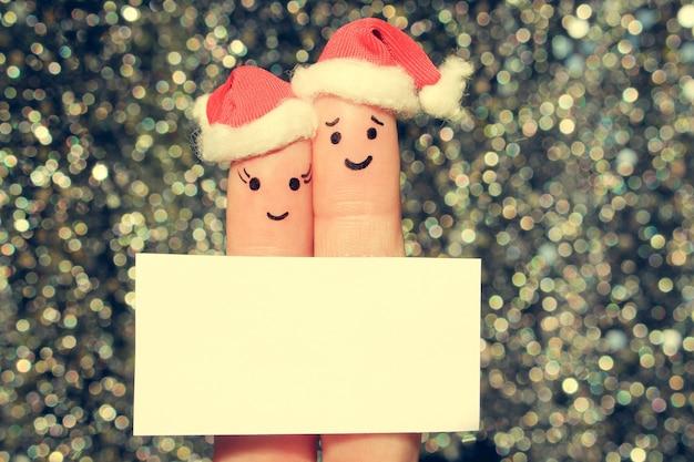 Искусство пальца пары празднует рождество.