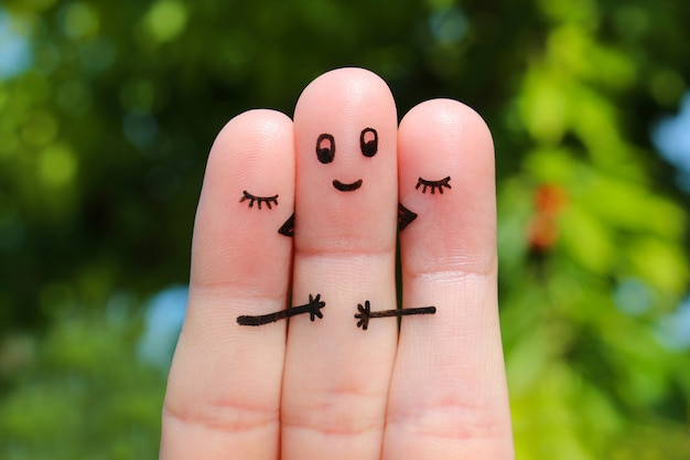 Finger art. two women kissing a man.