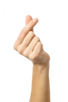 指の心。白で隔離される女性の手ジェスチャー