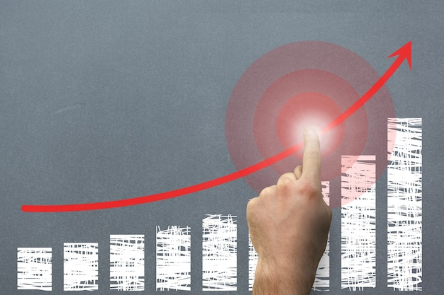 Finger indicating a graph rises
