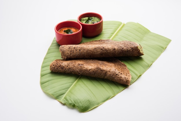 Finger millet orã'âragi dosaã'âis a healthy indian breakfast served with chutney, in roll, flat or cone shape