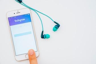 Finger, phone, instagram and earphones