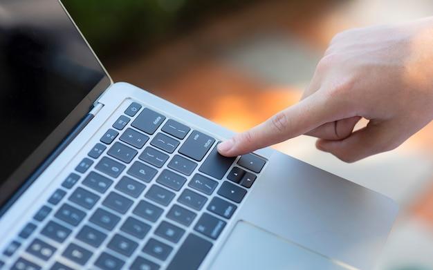 Finger pointing at enter key on keyboard