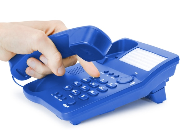 Finger presses the button on blue phone