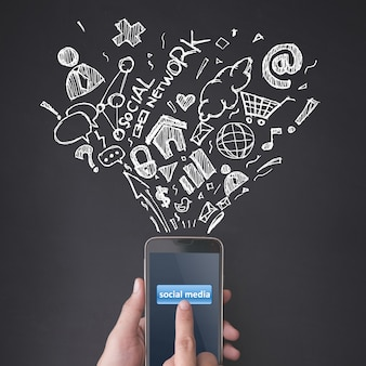 Finger pressing a smartphone with social media concept