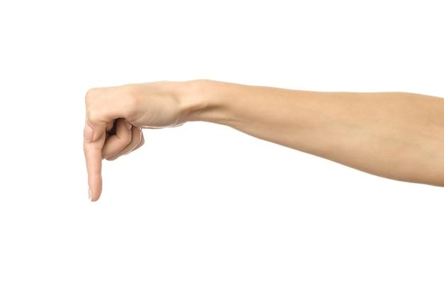 손가락이 닿거나 긁힘. 프랑스 매니큐어 몸짓 흰색 벽에 고립 된 여자 손. 시리즈의 일부