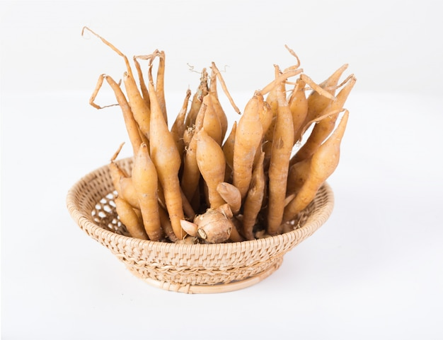 Finger root on bamboo basket, useful for thai herbs, spices and food ingredient Premium Photo