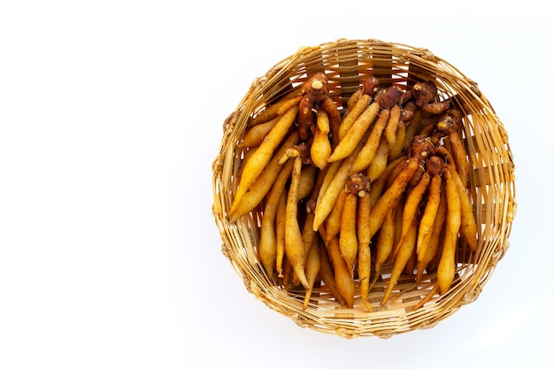 Finger root in bamboo basket on white background.