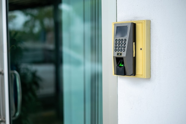 A finger scan access control system to lock and unlock doors and the time recorder for employees